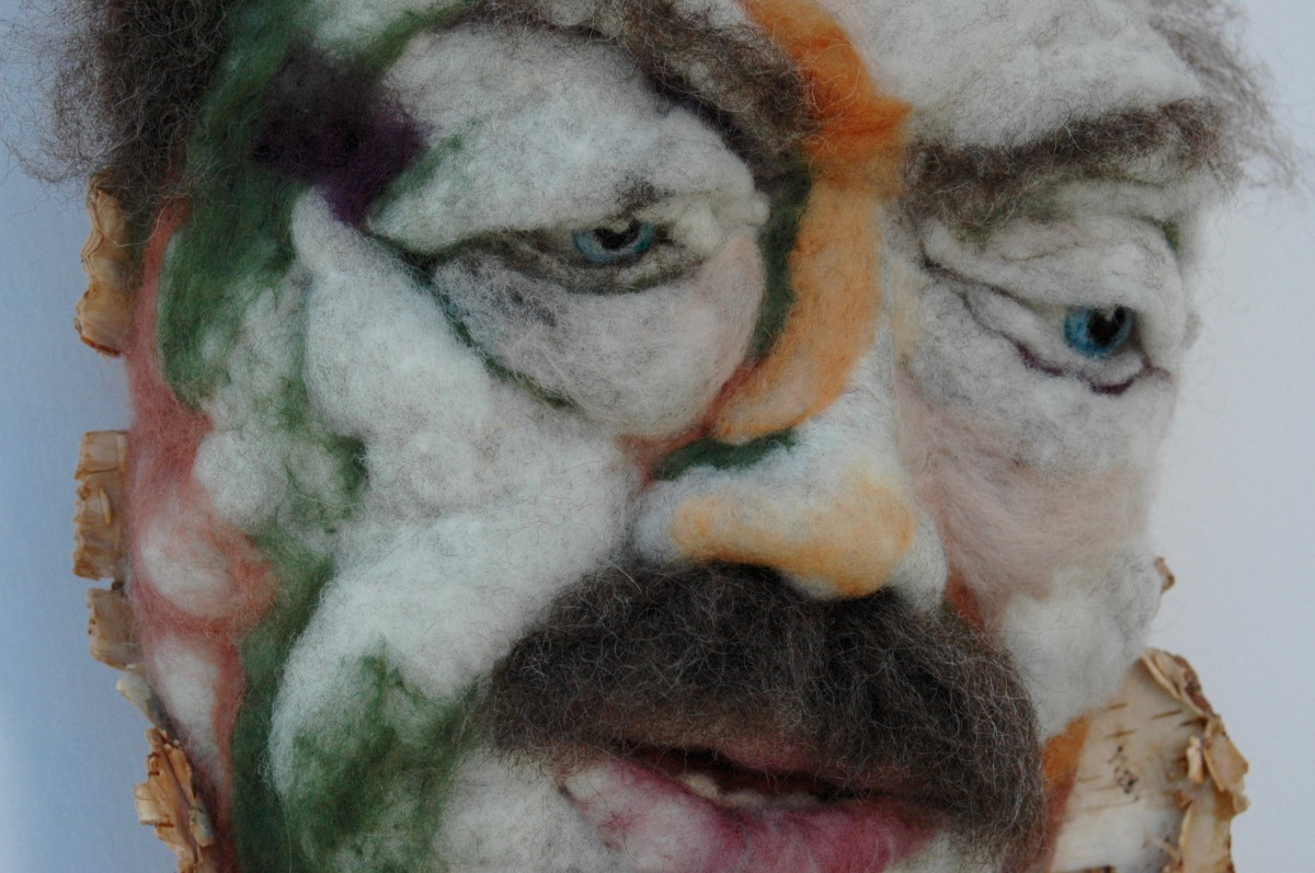 Télesphore_detail - Hand needle-felted wool sculpture of a male face, balding with bushy brown moustache. Mounted on reclaimed birch bark. Artist/photo: Rosemarie Péloquin.