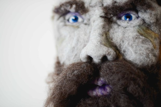 Ti-Jean - Hand needle-felted wool sculpture of a male face – dark brown hair, moustache and beard. Mounted on reclaimed birch bark. Artist: Rosemarie Péloquin; photo: Emily Christie.