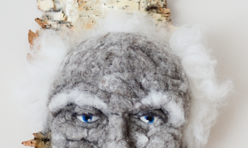 Oscar. Hand needle-felted wool sculpture on birch bark. Blue eyed male with floppy white hair. artist: Rosemarie Péloquin; photo: Emily Christie.