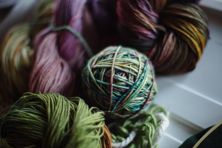 Ball and skeins of hand dyed, handspun wool. Photo by Emily Christie.